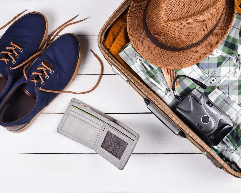 Open suitcase for travel with things and accessories