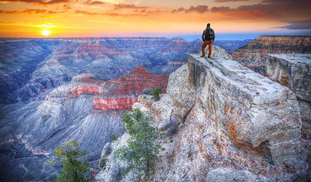 man in the Grand Canyon at sunris