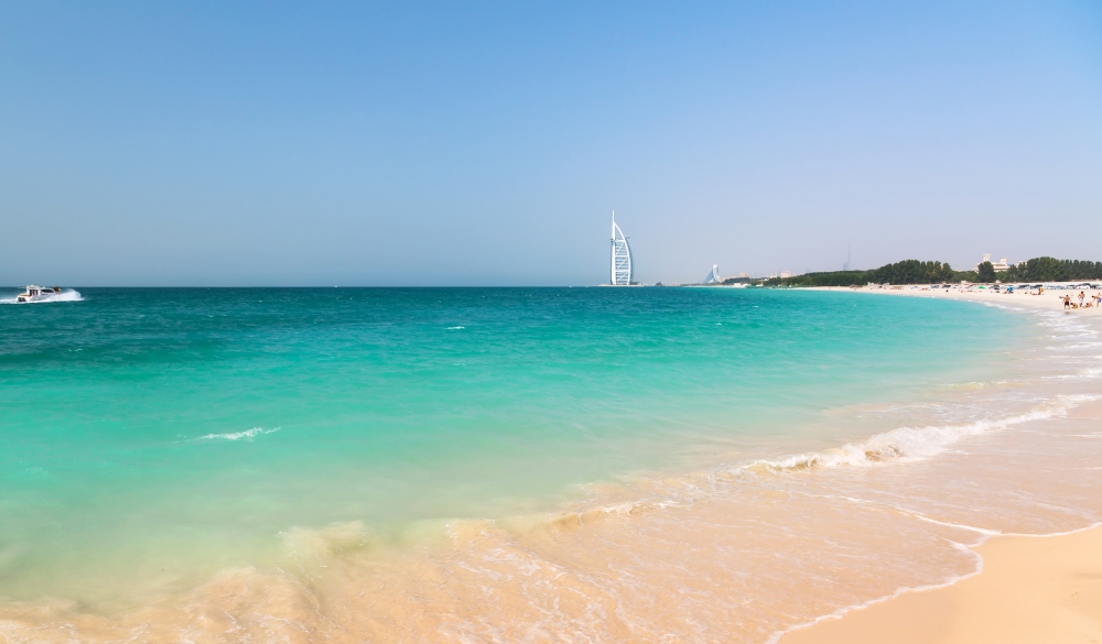 Public beach with turquoise water in Dubai,