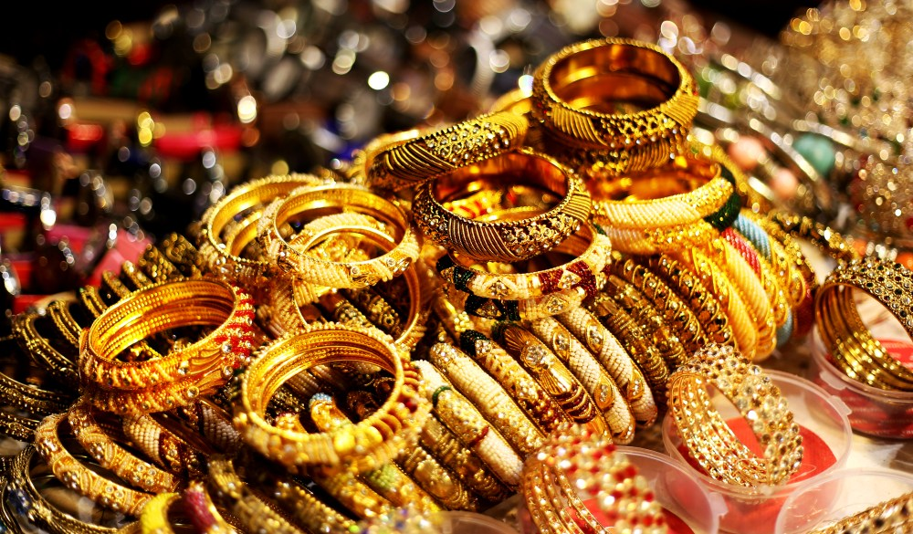 Bracelets and bangles in a row in street market in Dubai