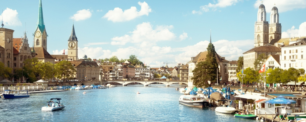 Zurich city center with famous Fraumunster, Grossmunster and St. Peter and river Limmat