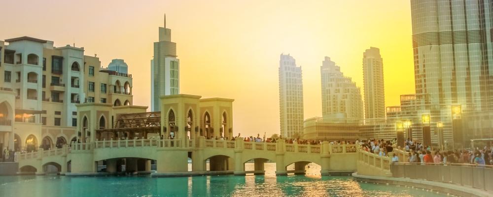 the Souk Al Bahar and Burj Khalifa at dusk in Dubai Downtown District,
