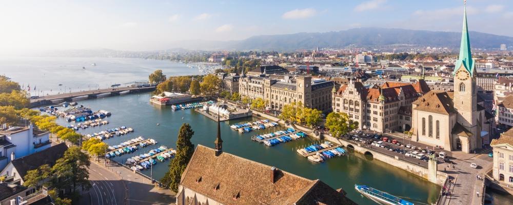 Zurich, Cityview, Limmat River, Town House Quai, Fraumuenster Church and Muenster Bridge