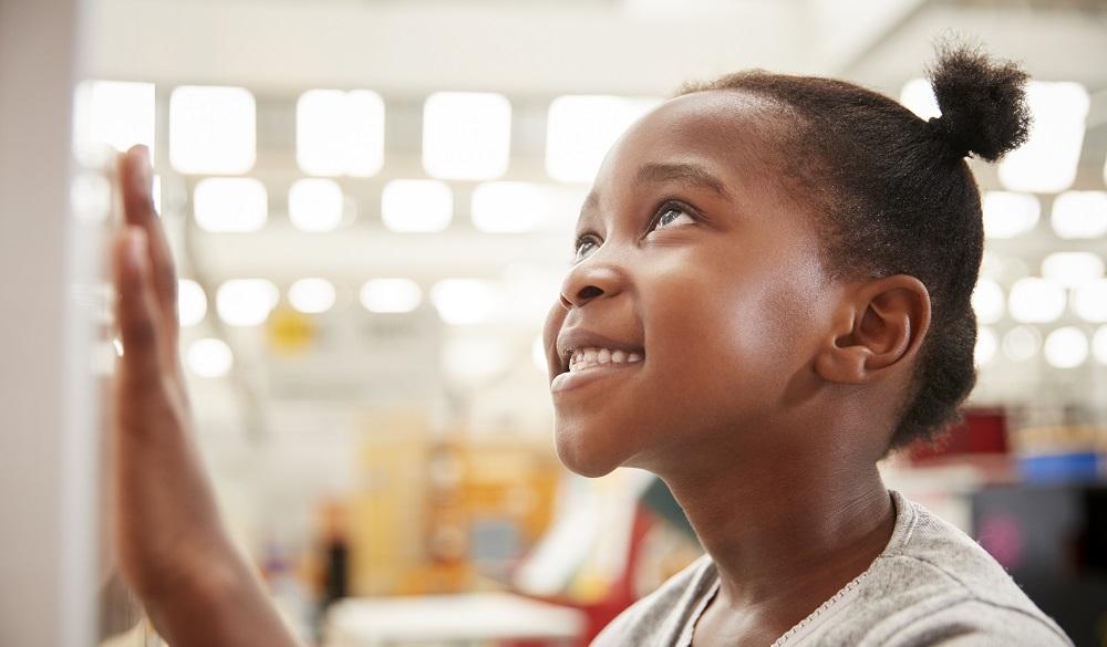 Young girl looking at exhibit in Boston Children's Museum