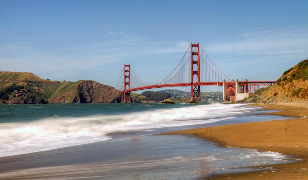 Baker beach with Golden Gate Bridge from afar