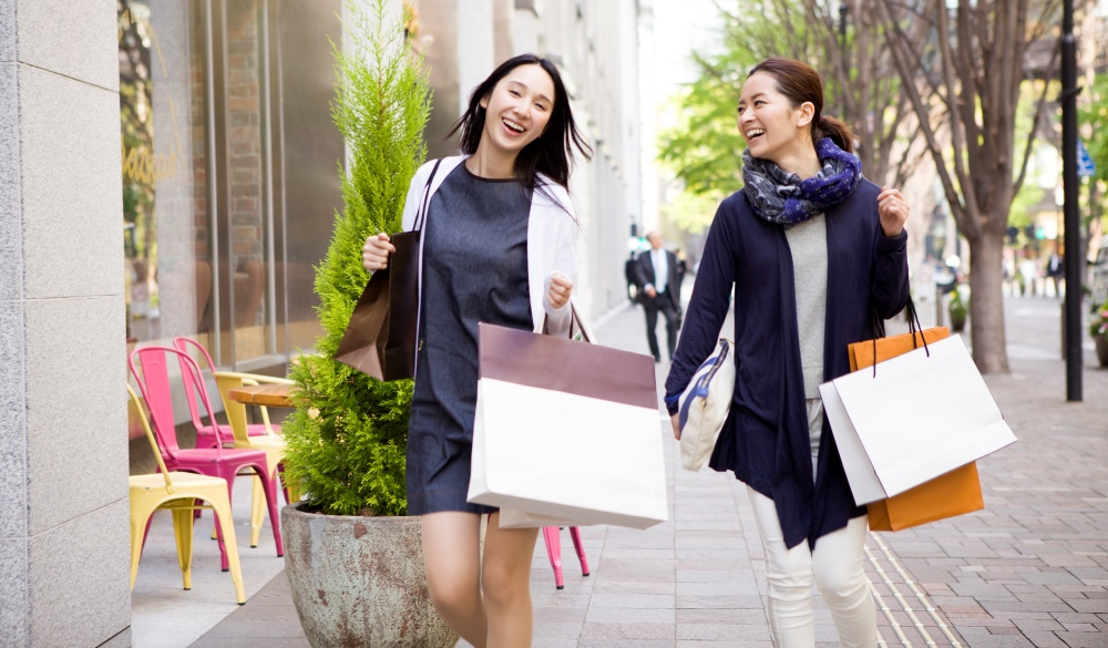 two female friends walking with shopping bags, tokyo