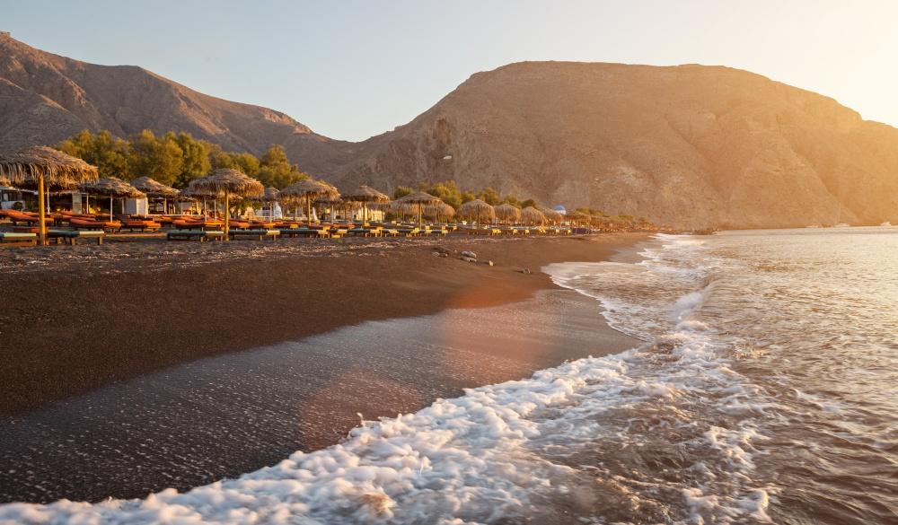 Perissa beach during sunrise on the Greek island of Santorini