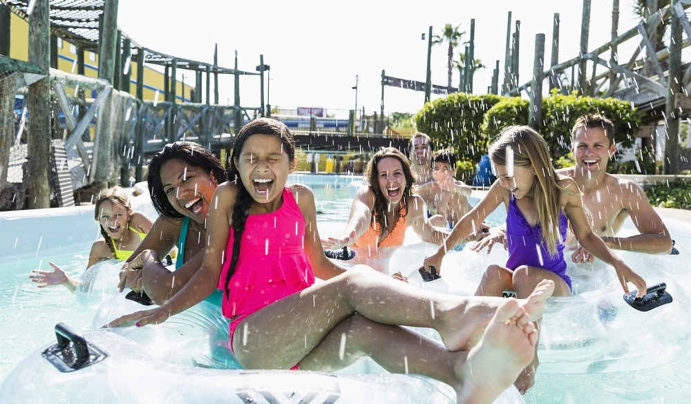 Orlando hotels with lazy river, Family in a waterpark