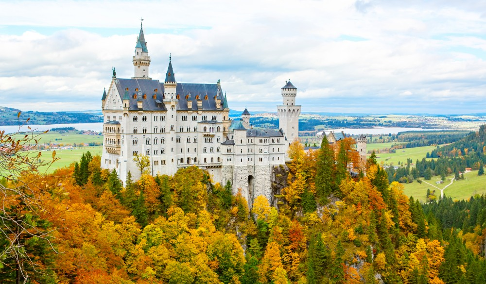 Neuschwanstein Castle, Germany. Image of the famous tourist attraction surrounded with autumn colors during fall