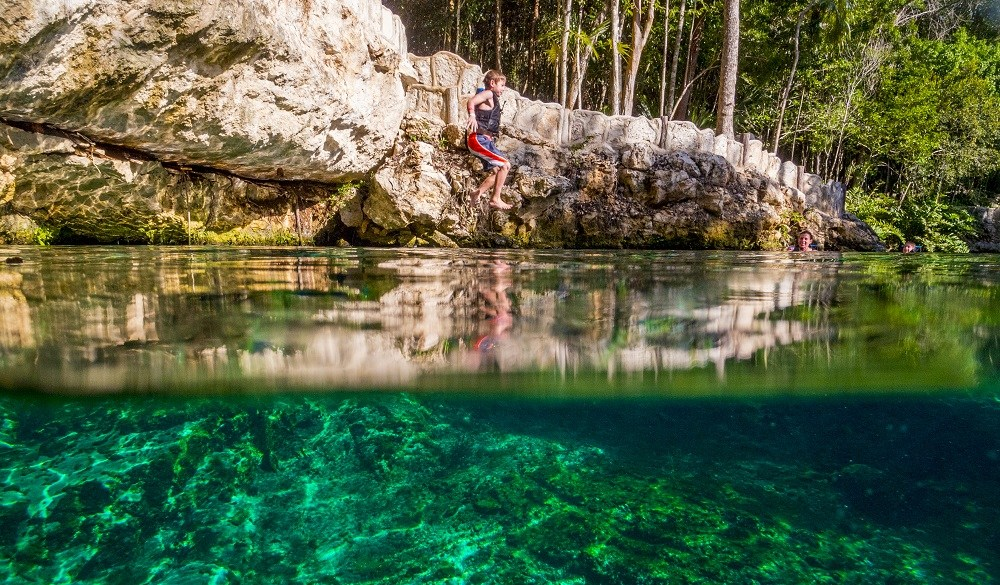Riviera Maya Kid friendly, boy Jumping In Tortuga Cenote
