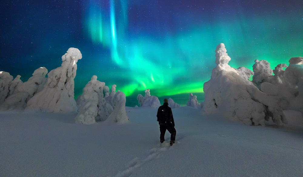 Man admiring the Northern Lights in Finland