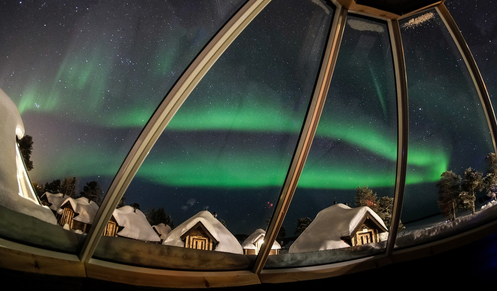 Colorful Aurora Borealis from an igloo hotel