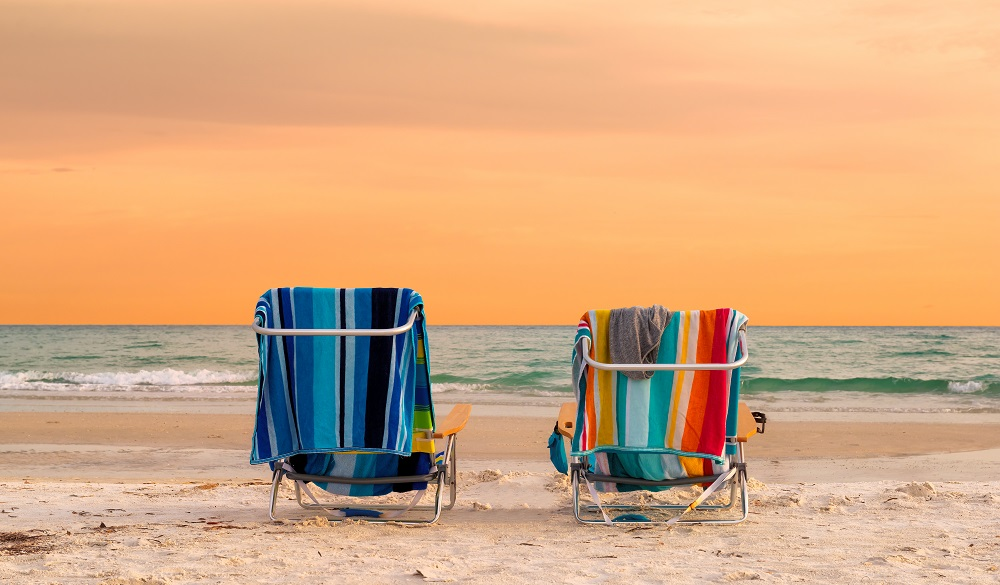Sunset view of Lounge Chairs in Siesta Key Beach