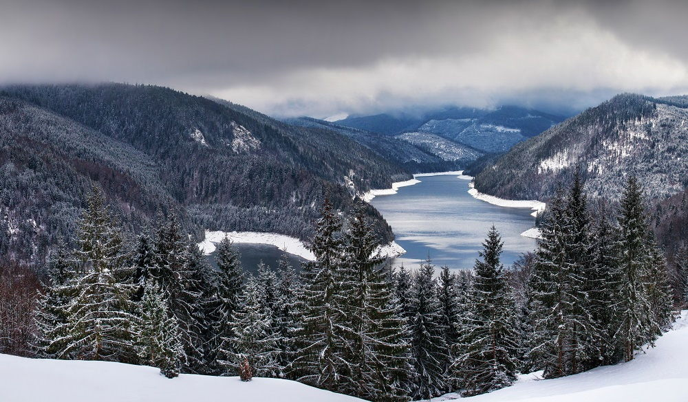 lake and snowy mountains in Romania