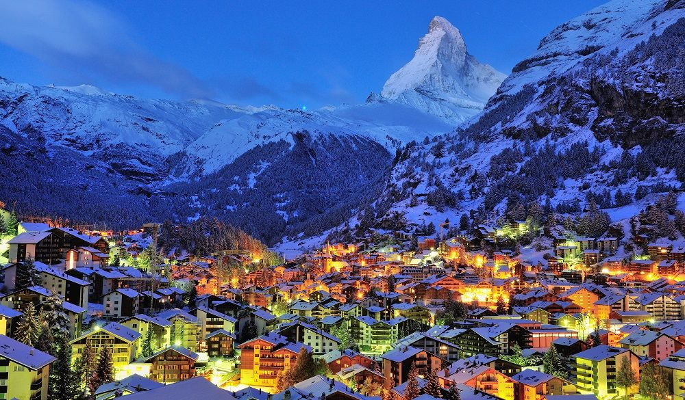 Switzerland village surrounded by snowy mountains