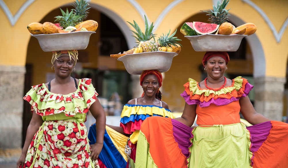 Happy group of women selling fruits in Cartagena