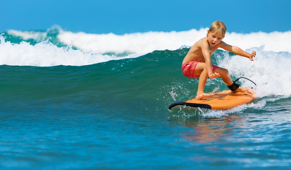 Young Surfer on Surfboard