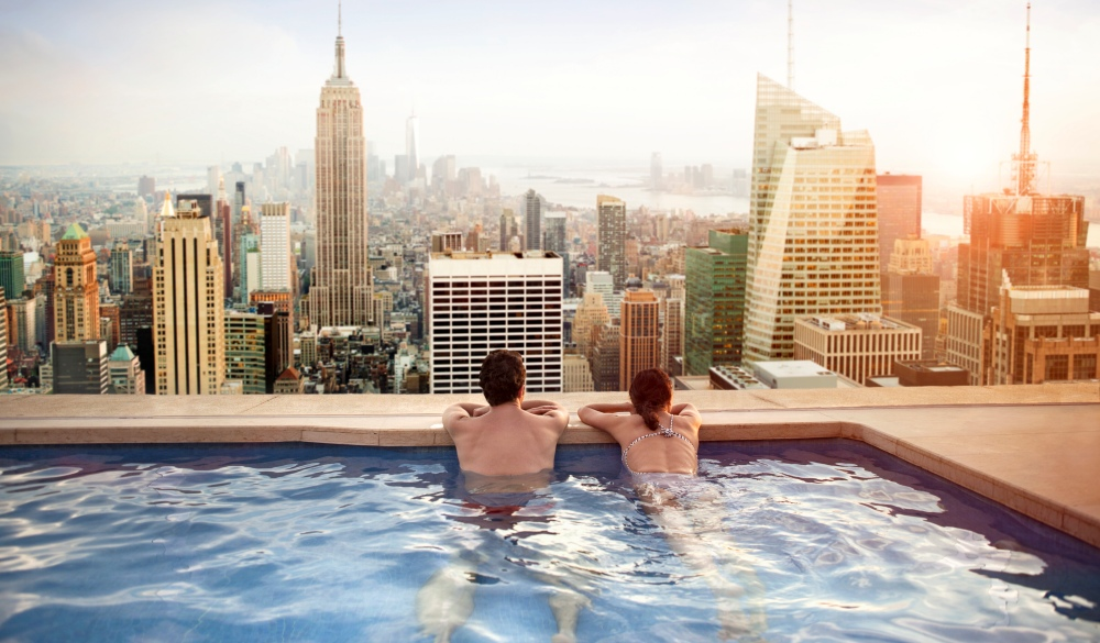 Couple relaxing on hotel rooftop, Manhattan