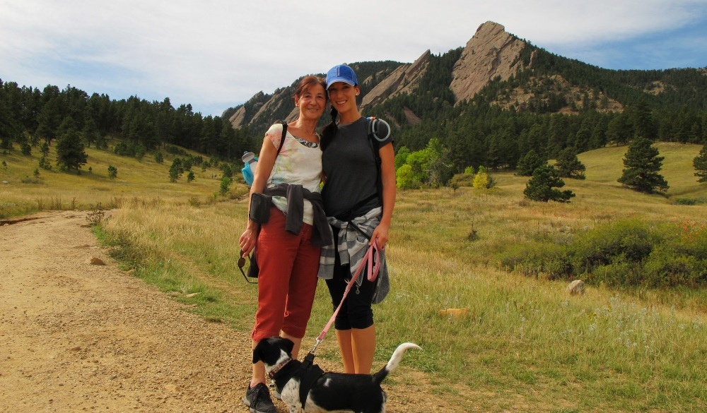 Two women with dog during hike, mother's day getaway