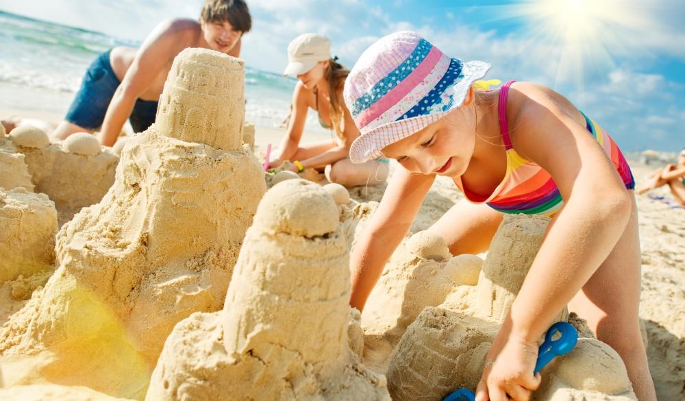 family building a sandcastle