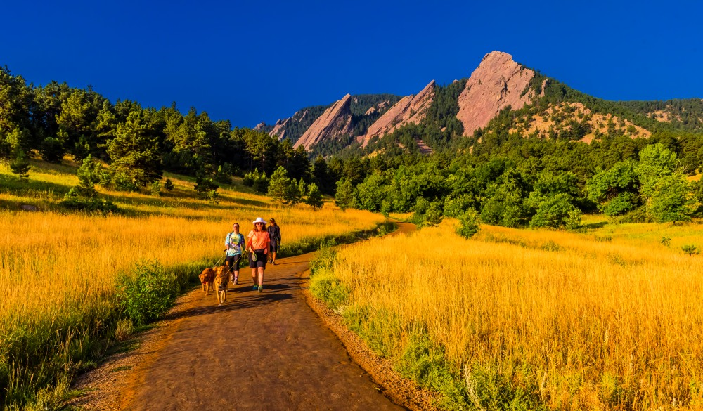 Hikers walking their dogs, The Flatirons Chautauqua Park, Boulder, mother's day getaway