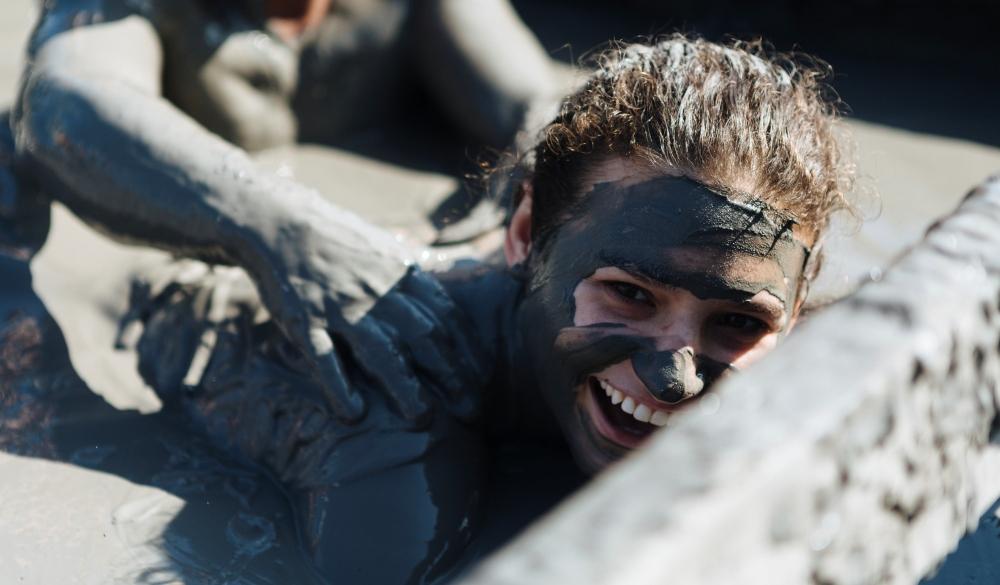 Group of friends swimming in El Totumo mud volcano in Cartagena. natural mud bath