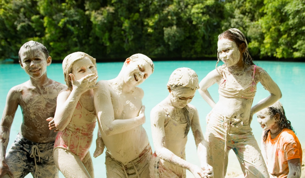 children in Milky Way, a lake in the Rock Islands with therapeutic mud., natural mud bath