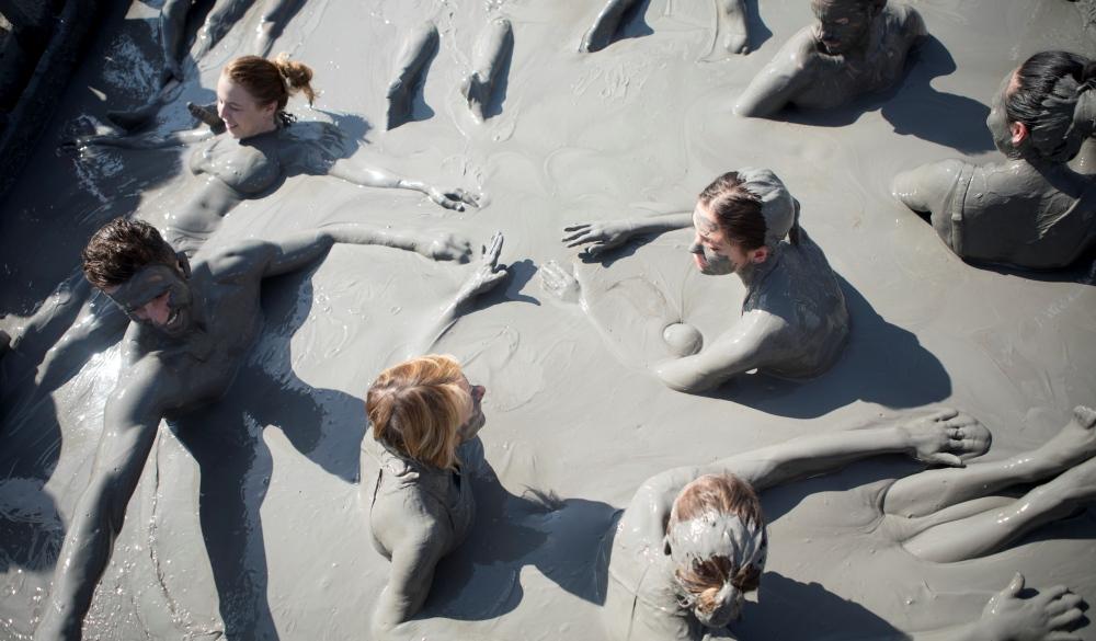 friends swimming in El Totumo mud volcano in Cartagena, natural mud bath