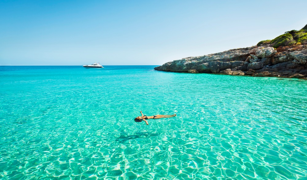 girl floating in fresh clean turquoise water, Tropical Island Vacations