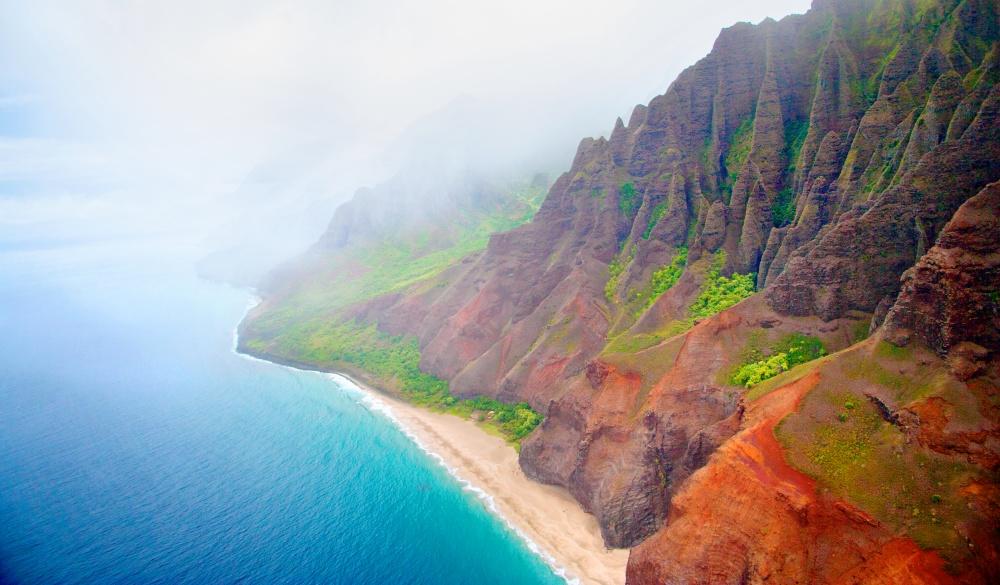 Kalalau Beach on rugged Na Pali Coast on north shore of Kauai, tropical island vacations