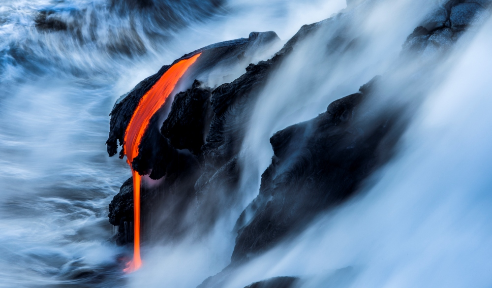 Lava from Kilauea spills into the Pacific Ocean off the coast of the big island