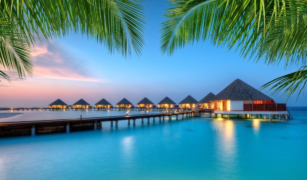 Water villas in lagoon, Maldives resort island, tropical island vacations