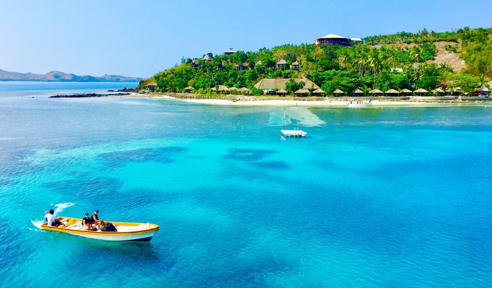 boat floating in Malakati, tropical island vacations