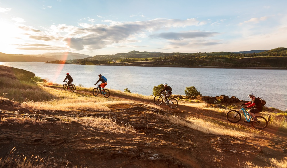 Mountain bikers ride along Columbia River. underrated U.S. destinations
