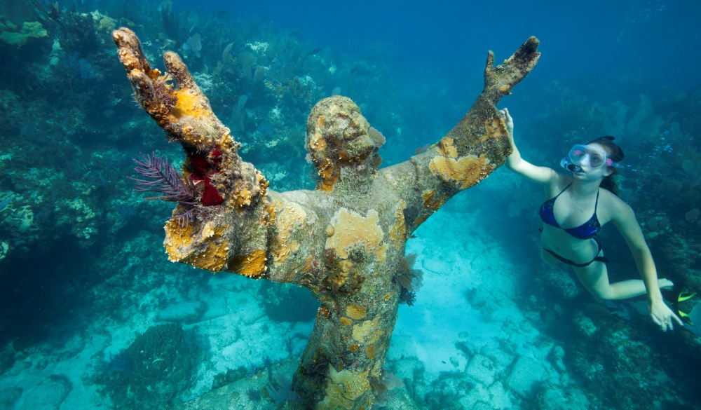 Snorkeler with Bronze Statue of Christ, underrated U.S. destinations