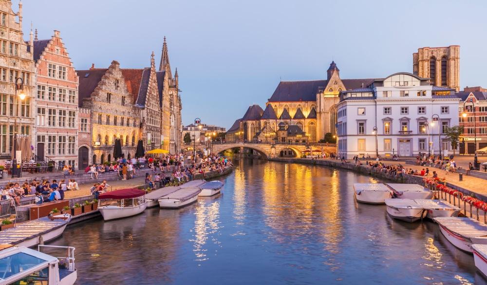 Belgium, Ghent, old town, Korenlei and Graslei, historical houses at River Leie at dusk