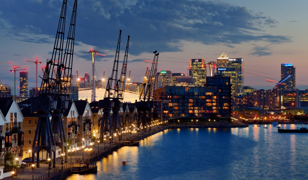 Elevated view of East London cityscape seen over Royal Victoria Dock at dusk