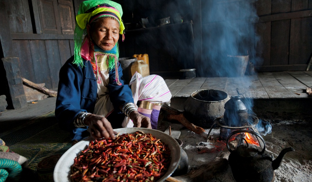 Burmese woman cooking traditional cuisine