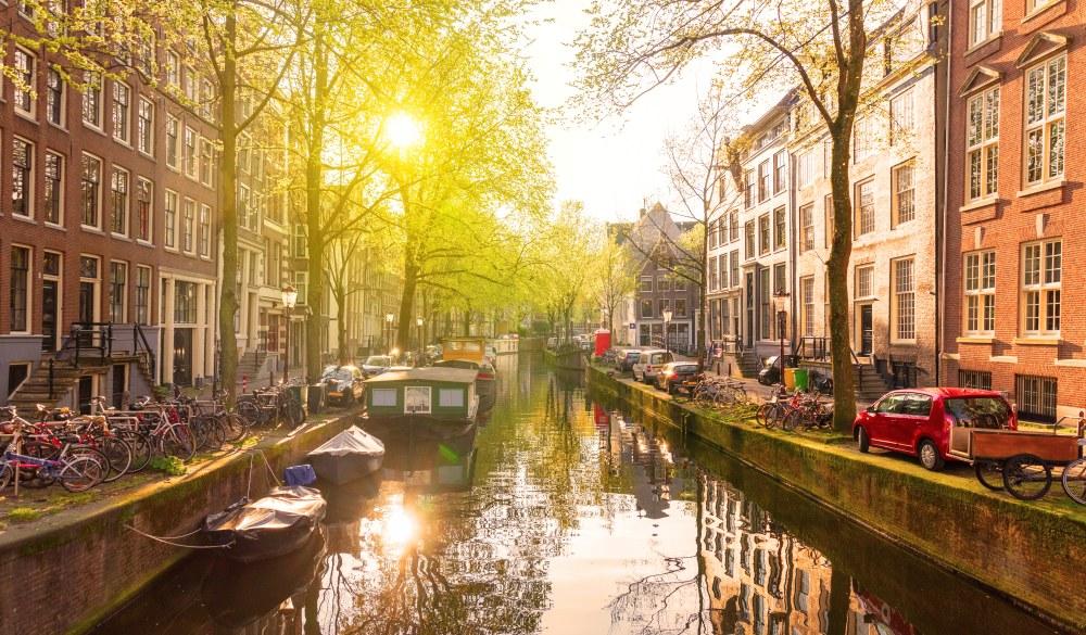 Sunrise in Amsterdam canal