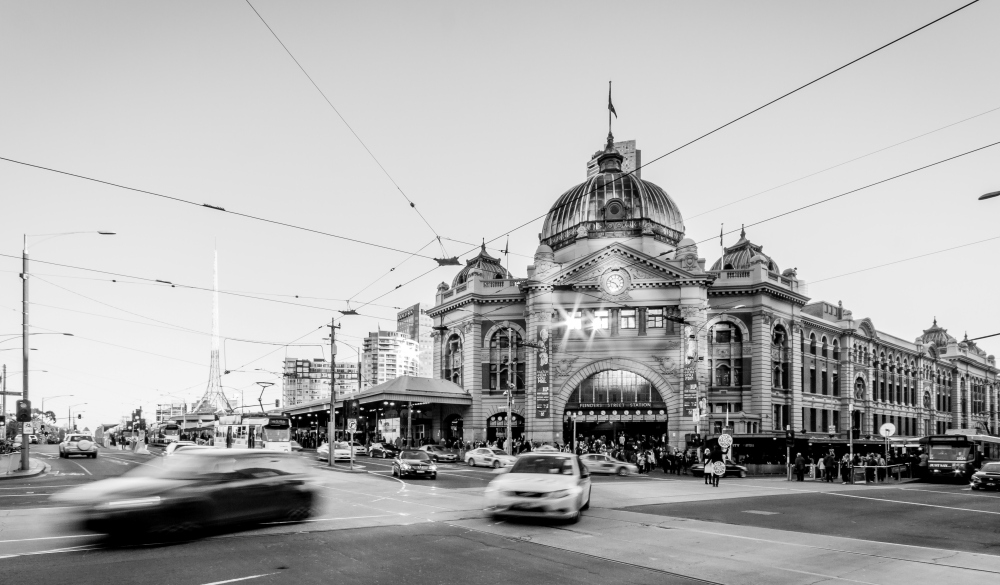 a car in front of iconic Flinders Street Station, stay in Melbourne