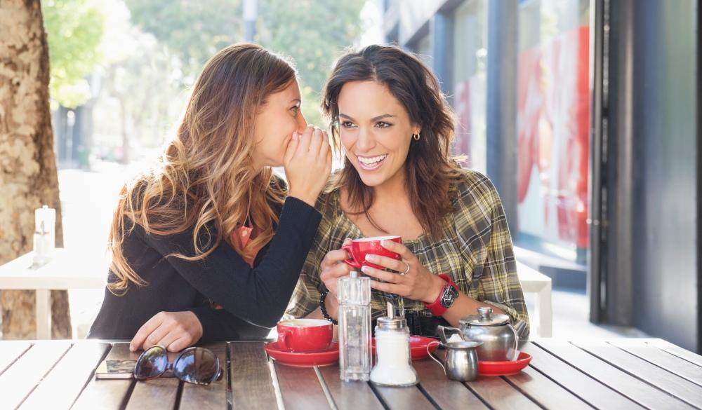 women having tea at sidewalk cafe