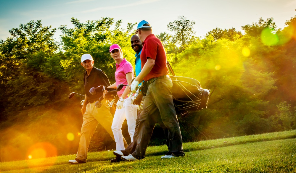 Four friends on golf course.