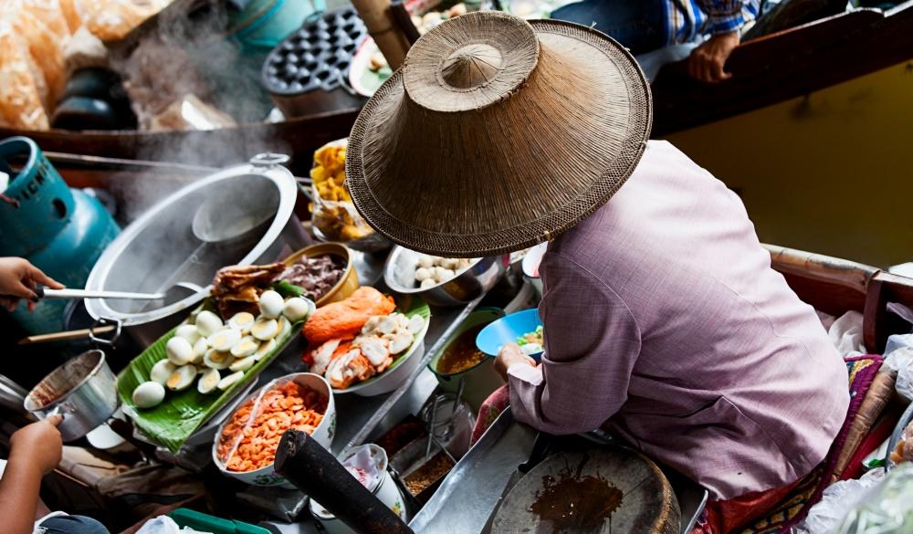 Food vendor at the Damnoen Saduak Floating Market near Bangkok.