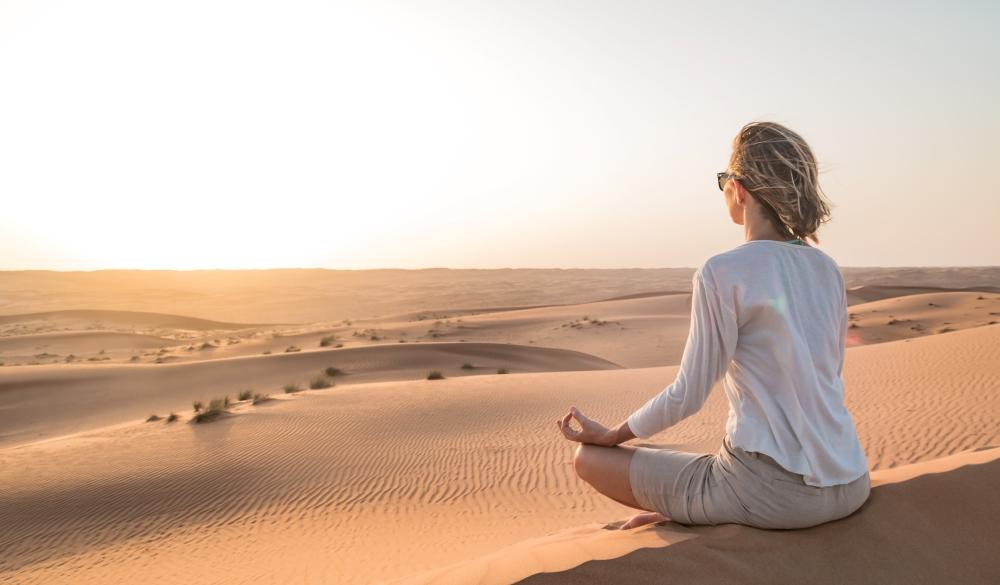 Woman Doing Yoga At Desert