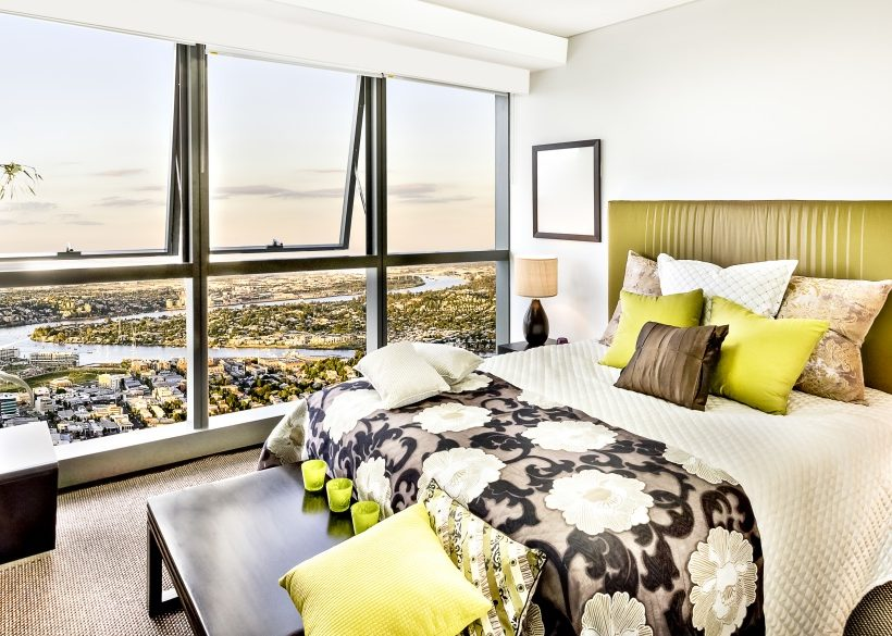 Colorful modern bed room near city view.