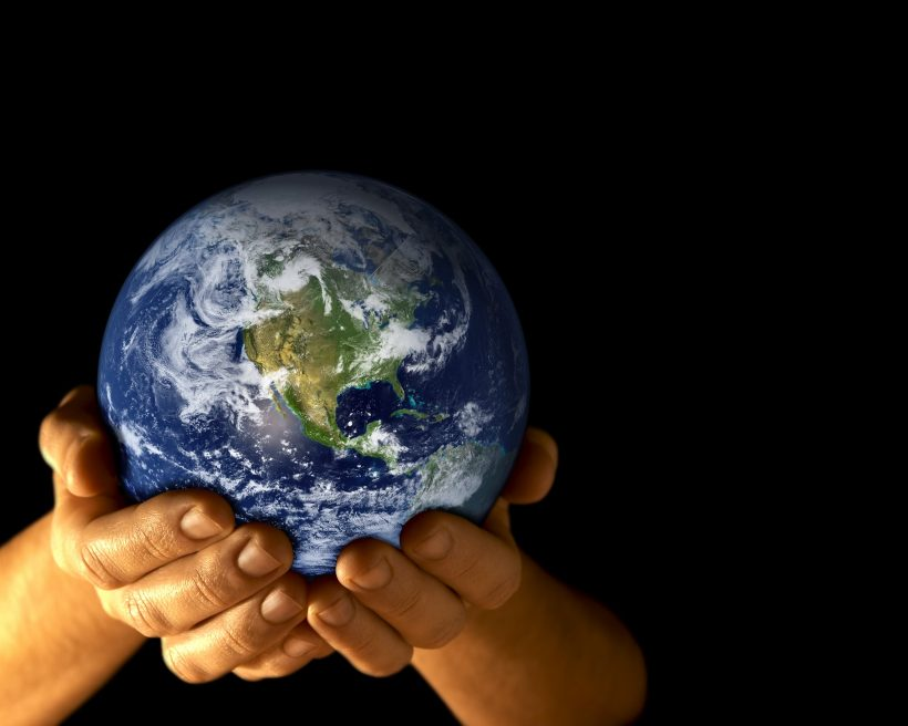 Man with planet earth in hands