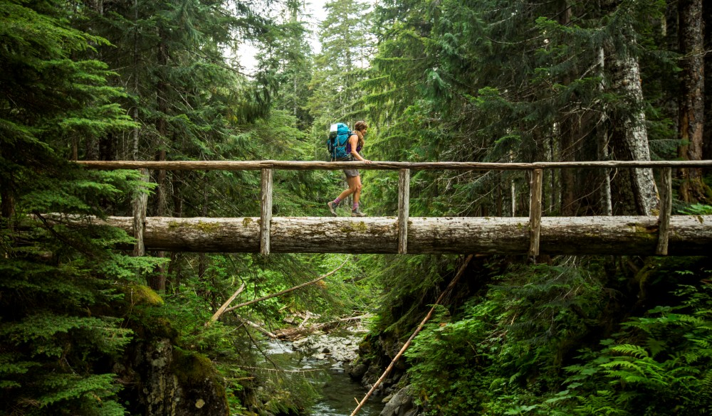 backpacking along a trail in the Olympic National Park, UNESCo site in the US