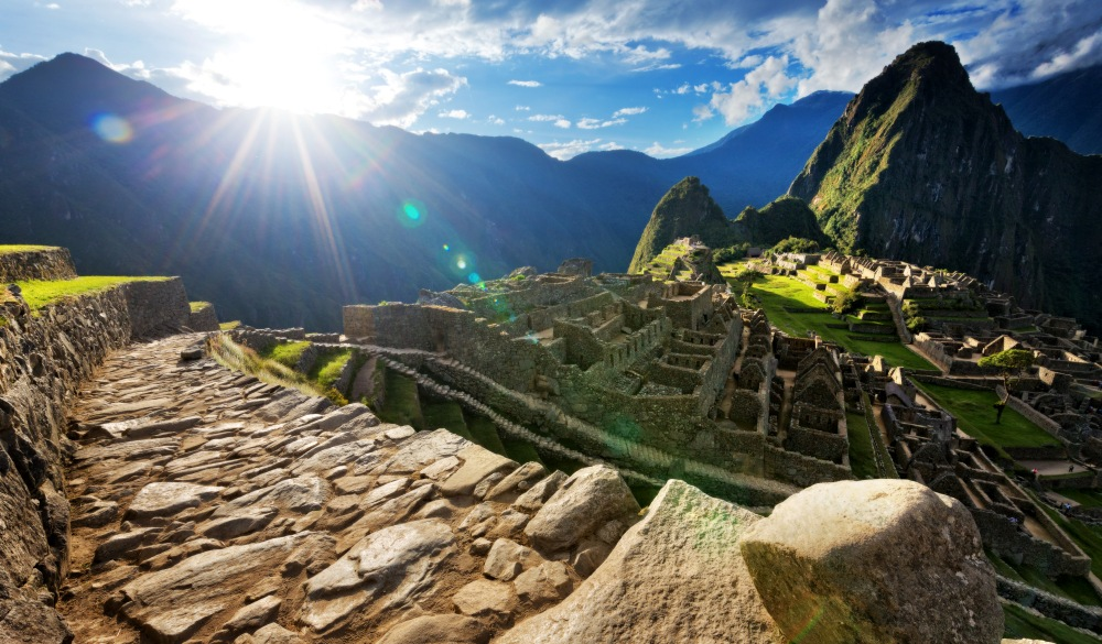 paved pathway overlooking Machu Picchu ruins, Peru, travel bucket list