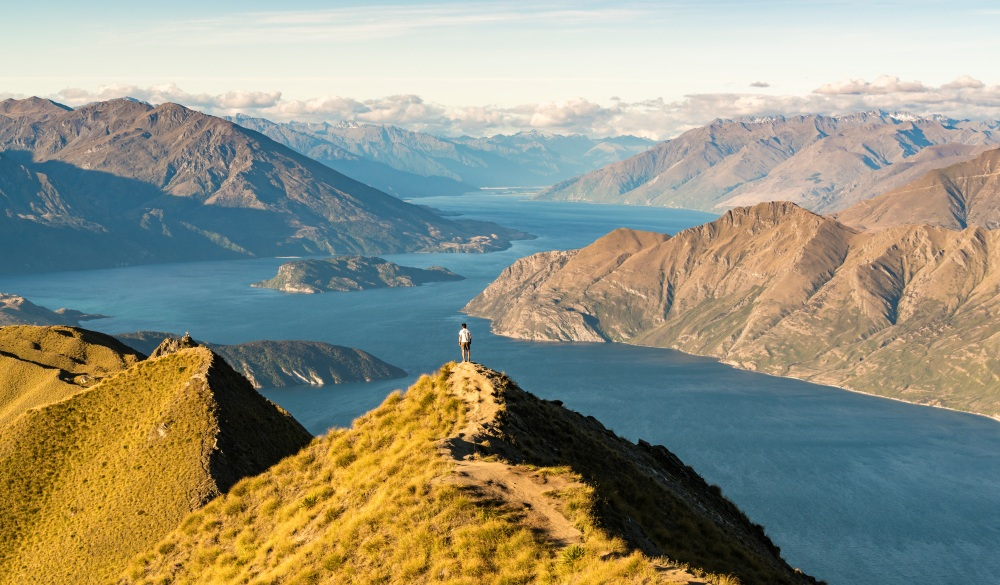 Man on Roys Peak, Wanaka, New Zealand.