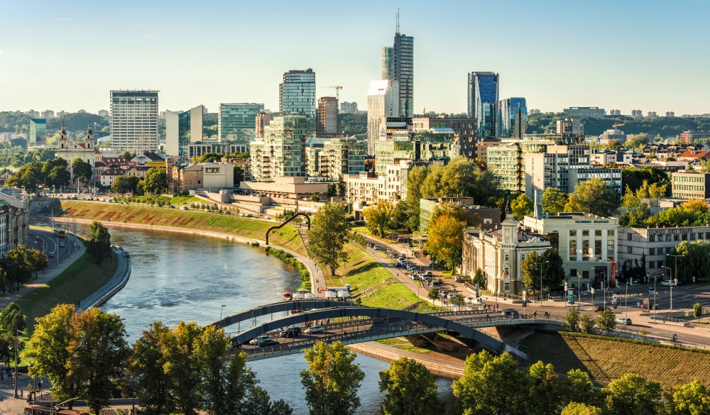 view to the modern city of Vilnius with Europa Tower and Neris River in the foreground, travel gems in europe